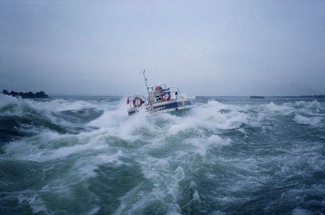 a-boat-fights-big-waves-off-the-coast-sisse-brimberg.jpg