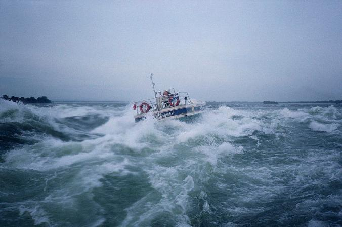 a-boat-fights-big-waves-off-the-coast-sisse-brimberg.jpg